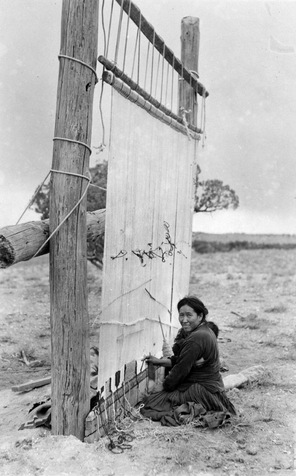 [At Zion National Park, a Navajo woman demonstrates traditional rug weaving techniques, Union Pacific Museum Collection.]     At Zion National Park, a Navajo woman demonstrates traditional rug weaving techniques