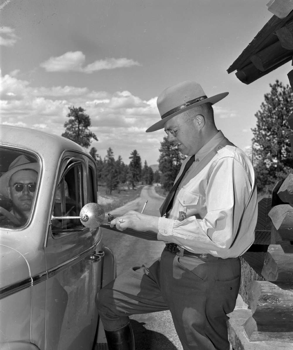 [A park ranger assists visitors at a Bryce Canyon National Park checkpoint, Union Pacific Museum Collection.]     A park ranger assists visitors at a Bryce Canyon National Park checkpoint