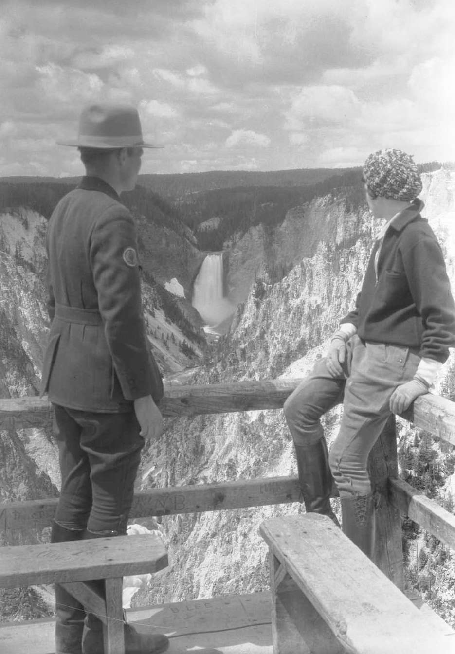 Ranger Frank Sissby and Julie Pressen of Chicago, Illinois, view the Lower Falls of the Yellowstone River and Grand Canyon of the Yellowstone